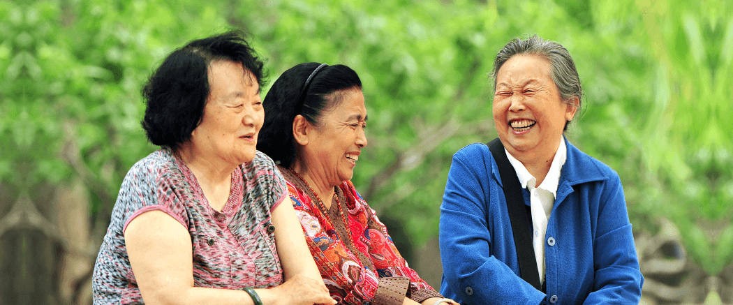 three elderly woman smiling