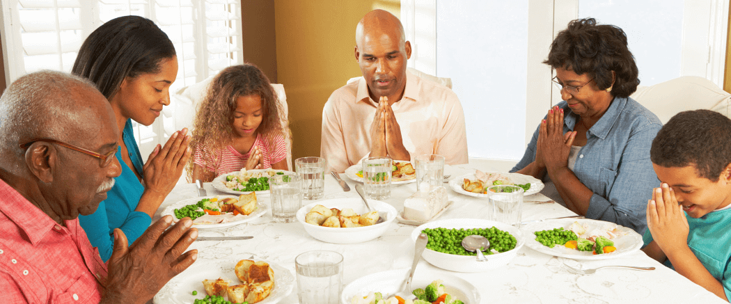family praying in the dining table