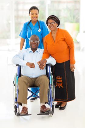 woman assisting two elderly seniors